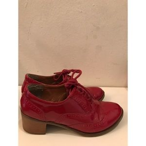 Red heeled Oxford shoes